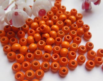 set of 150 round wooden beads orange
