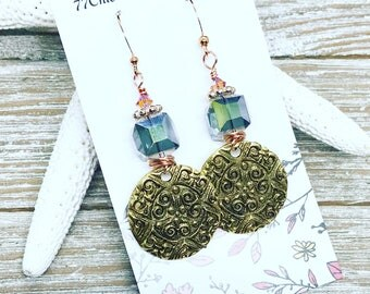 Medallions wire wrapped with crystal cubes and Swarovski crystal accents.