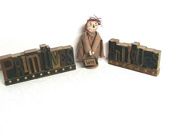 Wooden Primitive Antiques Signs and Little Wood Spool Doll