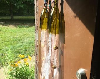Wine bottle yard art!!