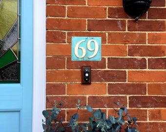 "Custom order for 32 x plaques in patinated copper, 3""/75mm,  polished and laquered, 2 x numbers g"