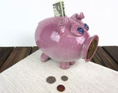 Pink ceramic piggy bank f...