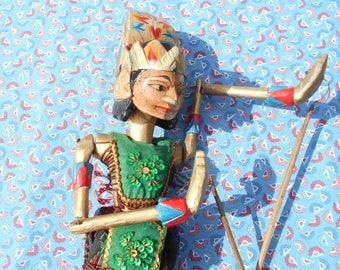 Wayang golek puppet, vintage Indonesian wooden rod puppet from Java. Javanese folk art.