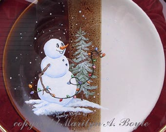 CHRISTMAS PLATE, HAND Painted:  snowman decorating the tree, Christmas lights, 8 inch plate, comes with stand, original, one of a kind
