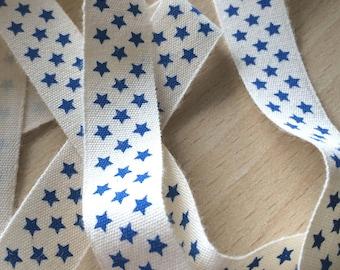"decorative Ribbon: ""blue stars"" on an ecru background"
