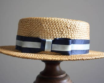 A vintage Straw Boater, made by J Shapely Hats of Cambridge.