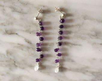 Earrings with amethyst drops.