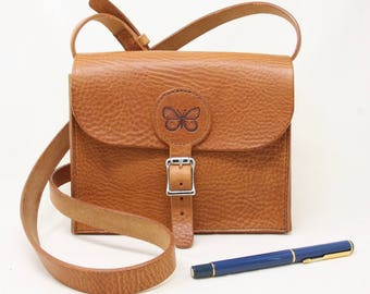 Small leather shoulder bag, hand-stitched, with butterfly motif