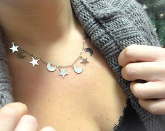 Steel necklace with star and moon pendants