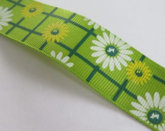 Pretty pale green ribbon with yellow and white flower pattern