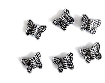 set of 10 Butterfly charms to put on 1 x 0, 9cm metal silver