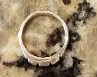 JULY SALE A band ring for him that is 4 mm wide completely hand formed in Pmc pure silver.  3 rectangles carved on the top have diagonal inc