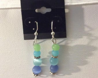 Earrings; glass bead, Shades of blue and green with silver accent