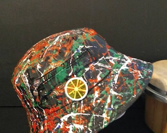 Hand painted wearable abstract art on a black bucket hat size 58cm adults inspired by the stone roses and Jackson Pollock made in Manchester