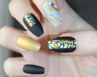 Matte black and gold coffin shaped false nails ! false nails, matte nails, fake nails, marble nails, gold nails