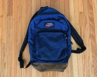 Vintage 90s Nike Navy Classic Zip Backpack.