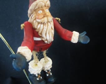 Santa Claus Christmas Ornament - he has articulated arms and legs made of cord with big boots. Delightful facial expression. Cute fellow!