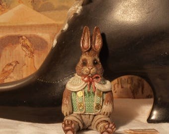 12th scale model of a seated and dressed toy rabbit