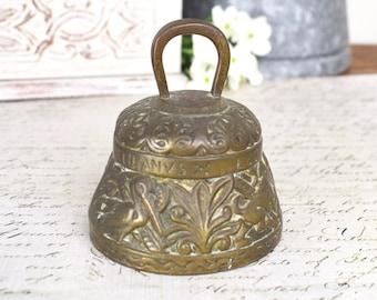Rustic embossed brass vintage metal bell.