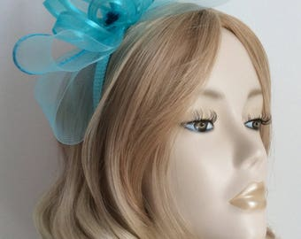 TURQUOISE FASCINATOR, Made with crin, organza ribbon, sequins,  on matching headband