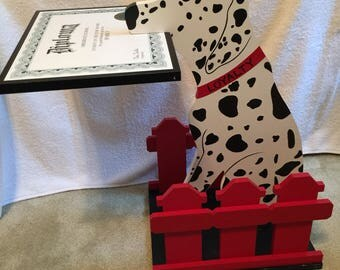 Dalmatian with diploma stand