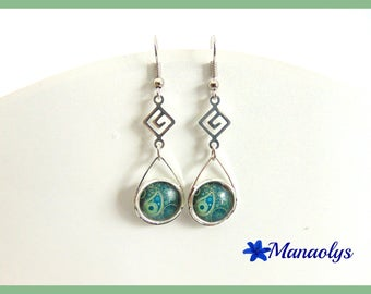Diamonds and drop earrings with green glass cabochons