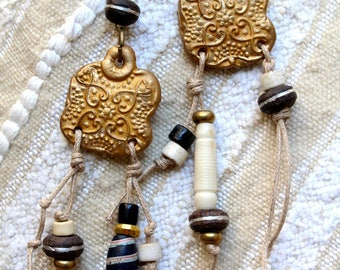 Asymmetrical earrings ethnic ivory, black and gold