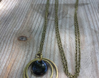 Bronze necklace and circle and black enamel pendant