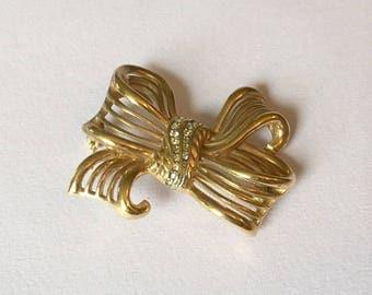 Vintage Trifari Bow and Rhinestone Gold Tone Brooch Designer Signed