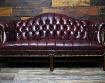 Vintage 1960's Chesterfield Camelback Couch Burgundy Tufted Leather Wood Legs Studded Loveseat Lounge Chair Living Room Furniture Office