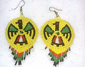 Beaded medallion fringed earrings / Thunderbird design / Yellow and green earrings