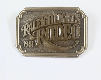 Cigarette Belt Buckle, Raleigh Lights Rodeo, 1981, Brown and Williamson, Brass Tone Vintage Belt Buckle, Mint in Plastic