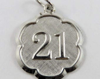 21 Sterling Silver Charm of Pendant.