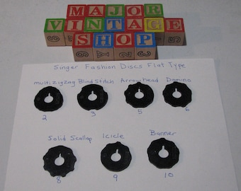 Singer sewing machine fashion discs in the flat top style , set of seven