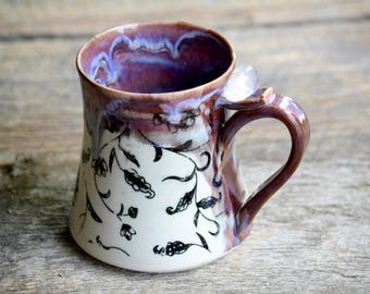 Large purple pottery mug with black flowers and Quartz crystal handle