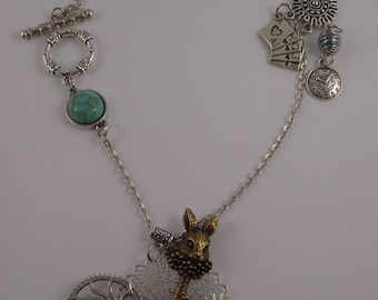 Steampunk necklace with gears, key rabbit from Alice the Wonderland, watch, game cards