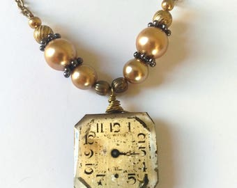 Steampunk necklace from upcycled watch movement with freshwater pearls and vintage chain