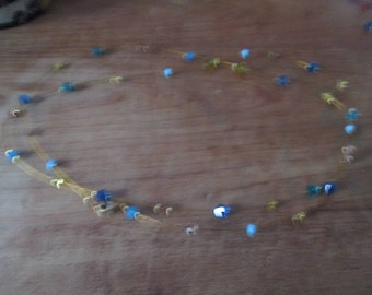 Blue, yellow diamond pearl necklace.