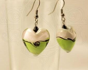 Earrings glass bead and swarovski, green, white and black.