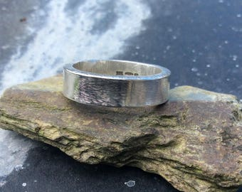 Silver band with hammered edge