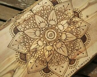 Mandala pyrography on a bamboo cutting board