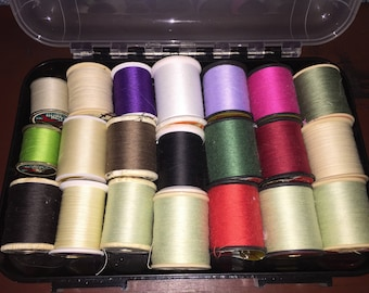 Great sewing notions box full of used spools of thread storage box is included