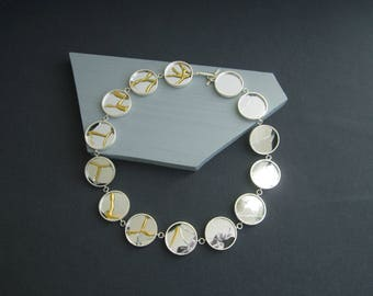 Healing Process. Elegant Necklace drapes gracefully showing broken mirrors to healed with Kintsugi in recycled silver