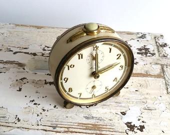 Old alarm clock 'Mauthe' gold