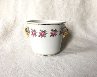 Romantic kitsch vintage flower pot with pink roses and gold rim and ears. Weisswasser Germany.