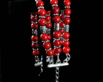Triple strand bracelet with red dyed bamboo beads