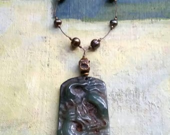 Carved jade dragon pendant necklace