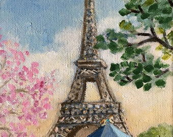 Carousel and Eiffel tower in spring