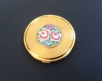Vintage Kigu powder compact, gold toned with inset petit point floral embroidery