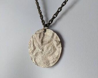 Rustic White Metallic Pendant Necklace on a dark gold chain